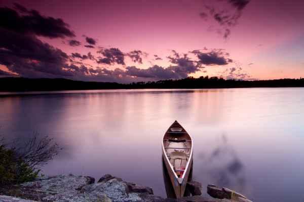 Carta da parati Tramonto con canoa